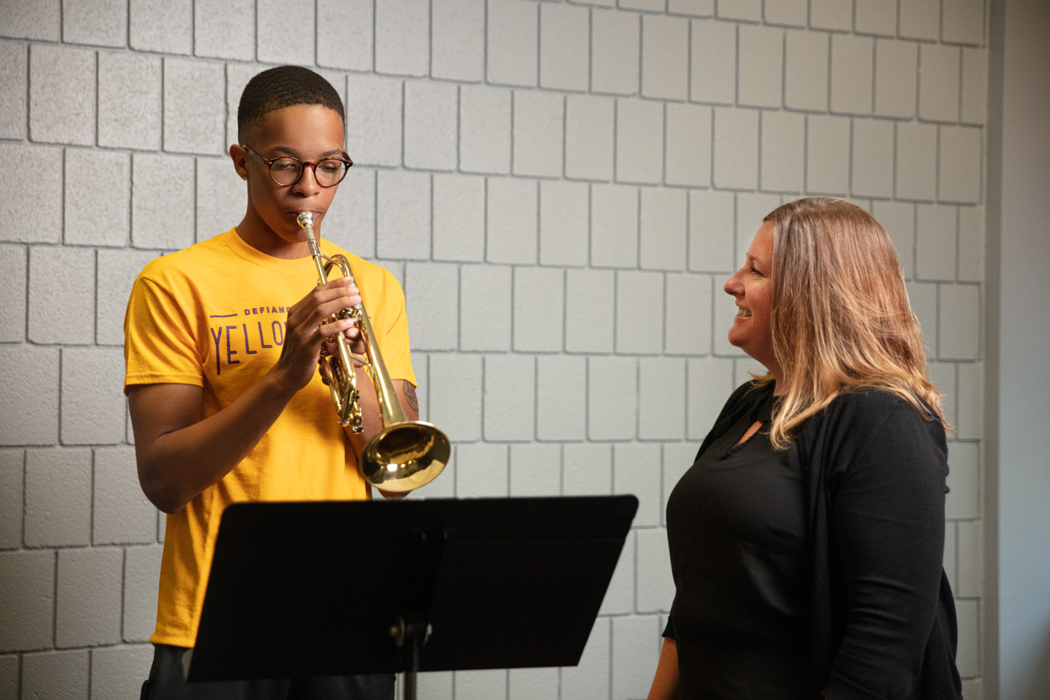 Teacher working with music student