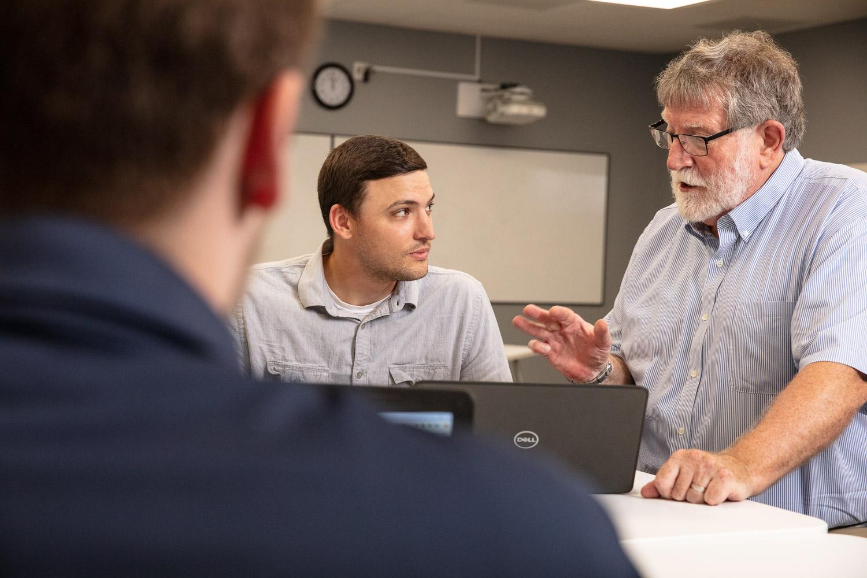 Teacher explaining concept to student