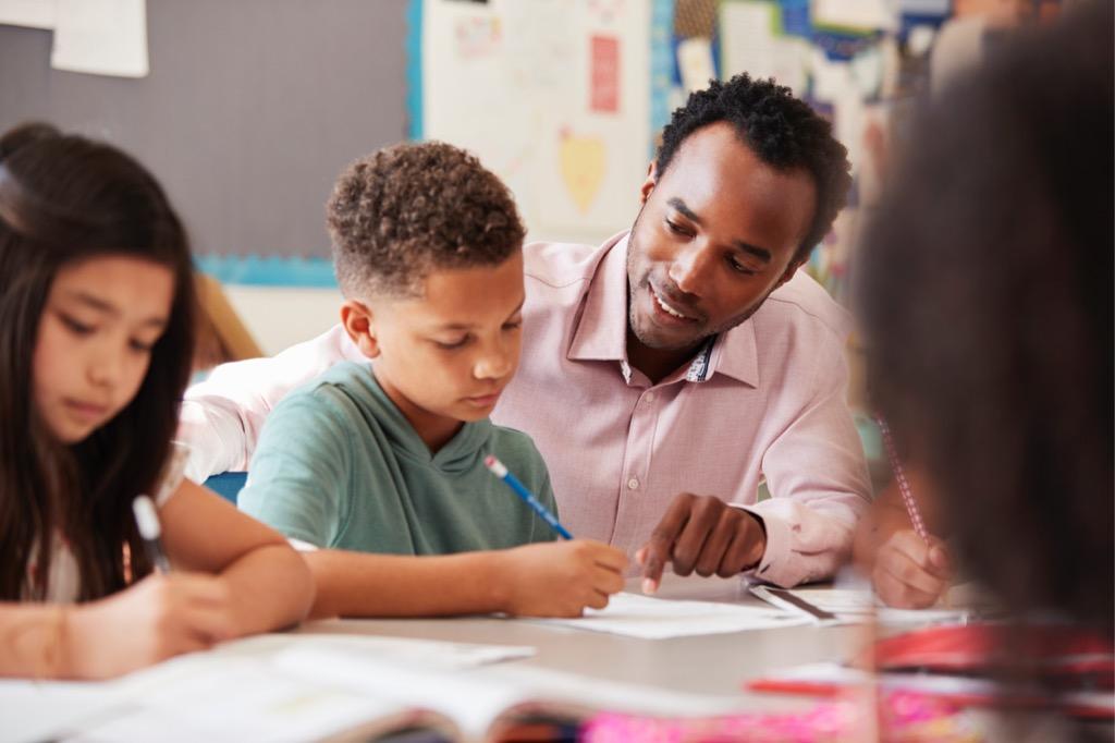 Teacher working with child.