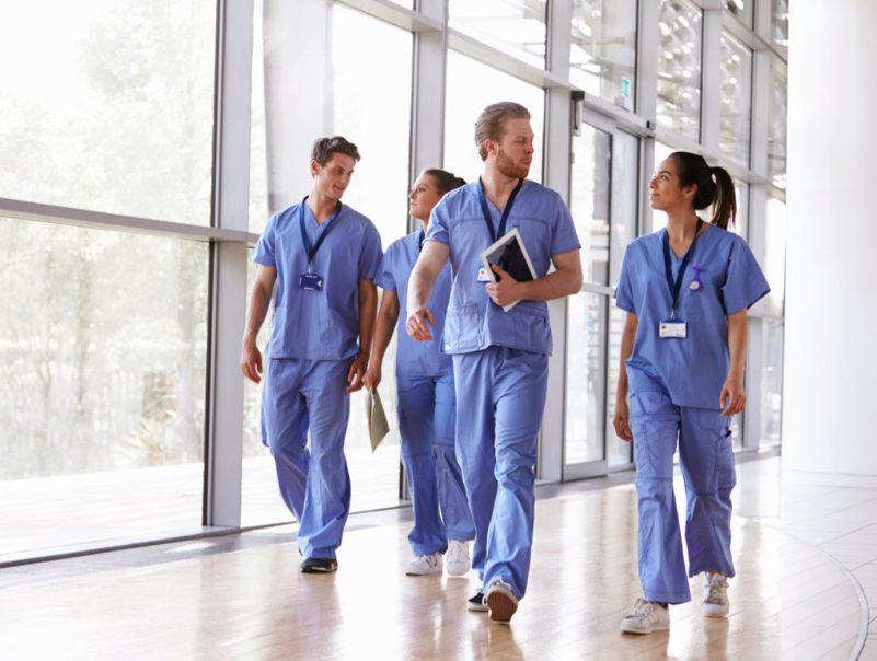 Group of nurses walking in hospital